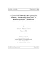 Experimental Study of Lagrangian Velocity and Energy Statistics in Inhomogeneous Turbulence
