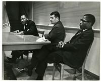 056 - Photo, Martin Luther King seated in front of classroom